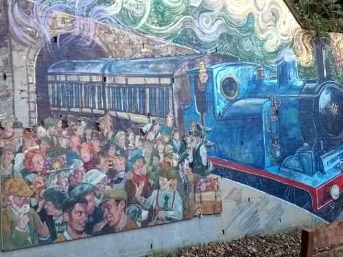 Wall with crowd and train